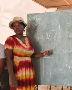 FOTCOH Woman at Chalkboard